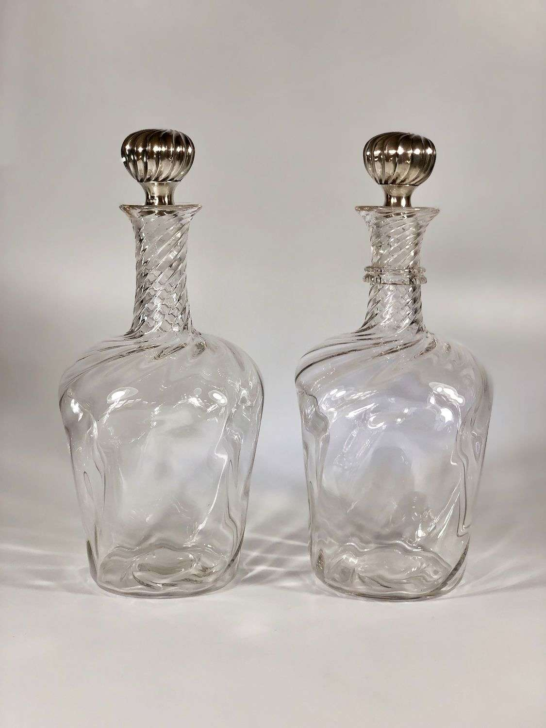 Exceptional pair of silver topped decanters