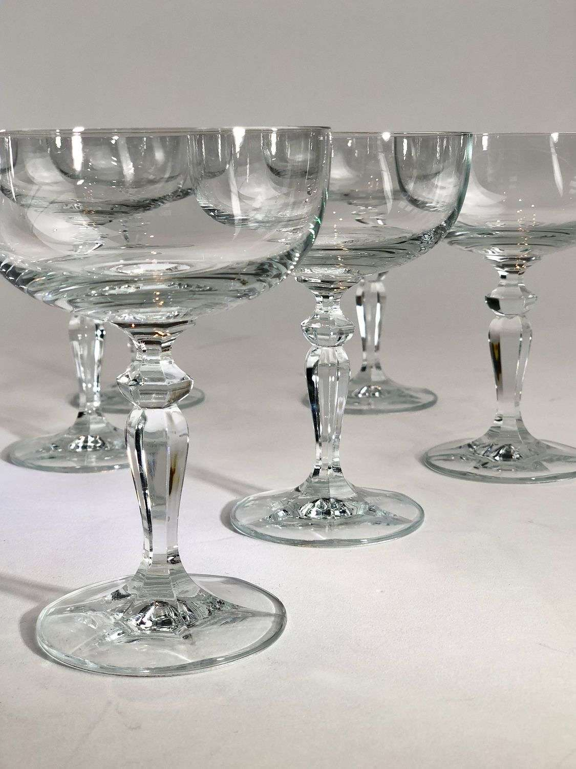 A dozen French crystal champagne coupes