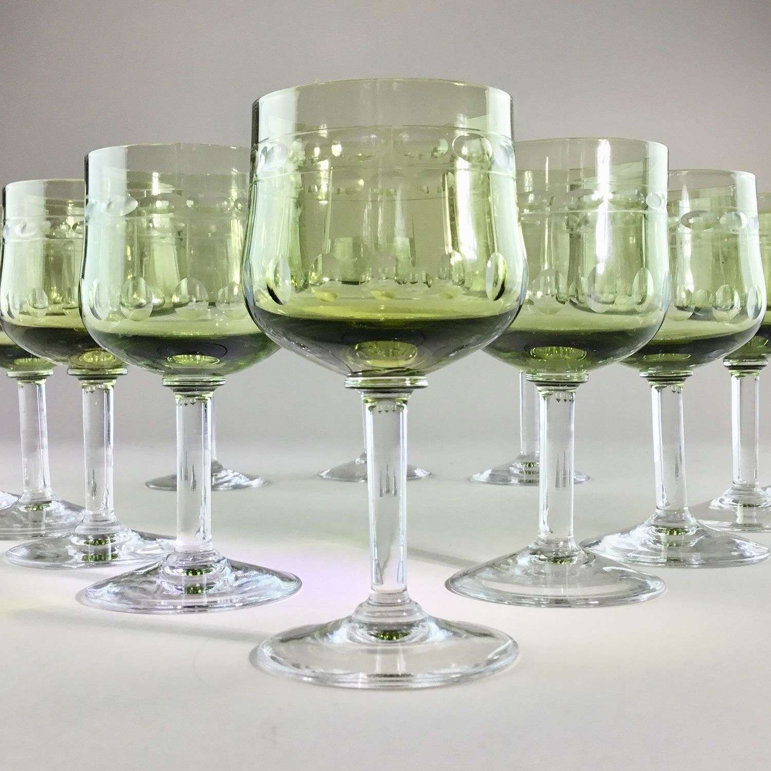 Ten pretty green tulip shaped glasses by Val Saint Lambert