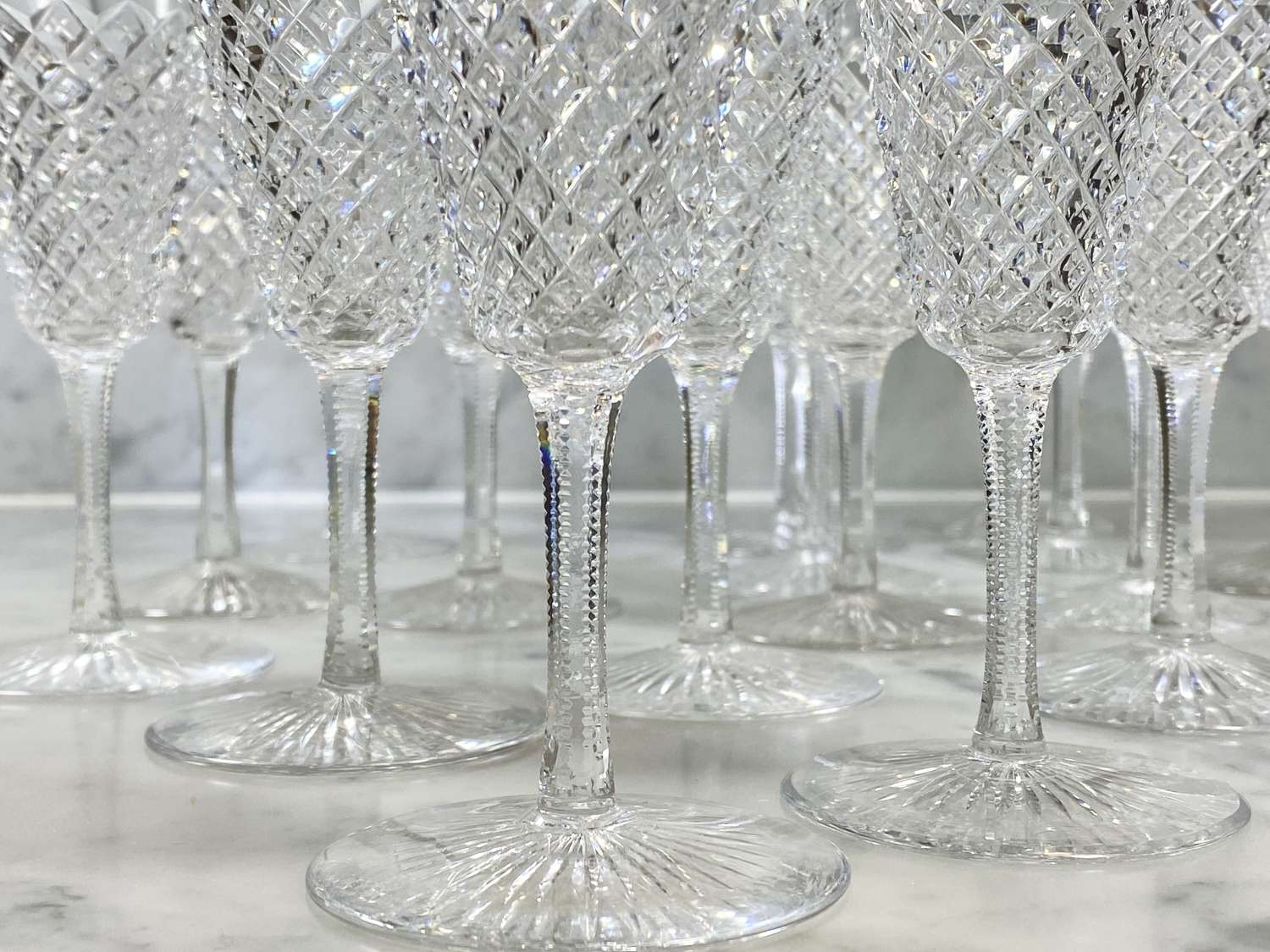 Extensive set of 16 early 20th Century diamond cut fluted glasses