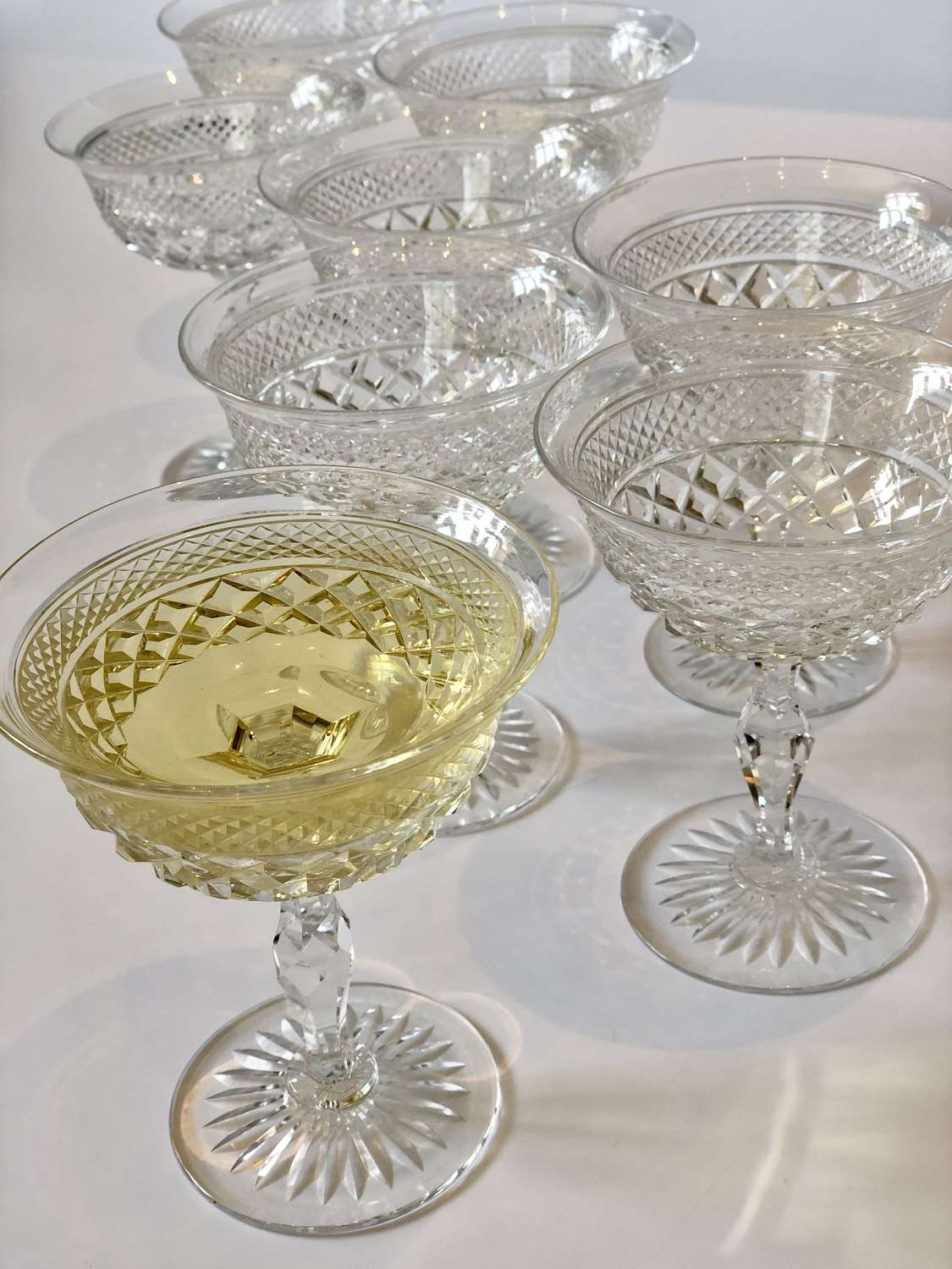 Eight English crystal champagne or cocktail coupe saucers