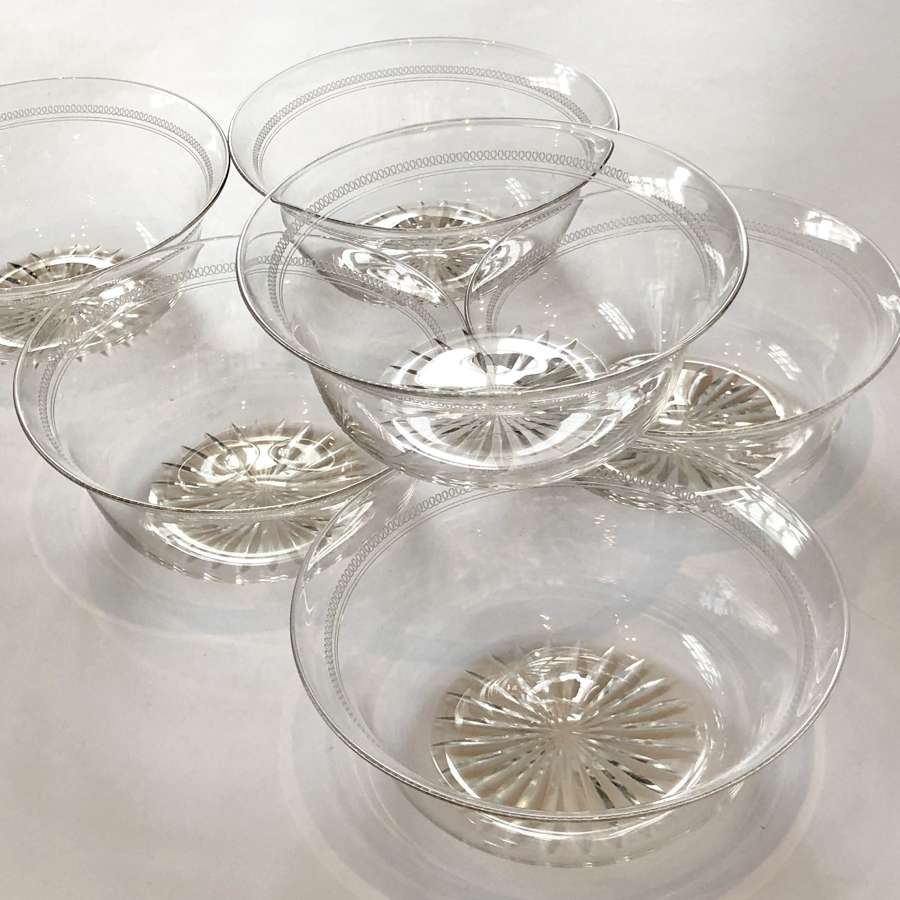 Set of six Edwardian cut glass and etched bowls