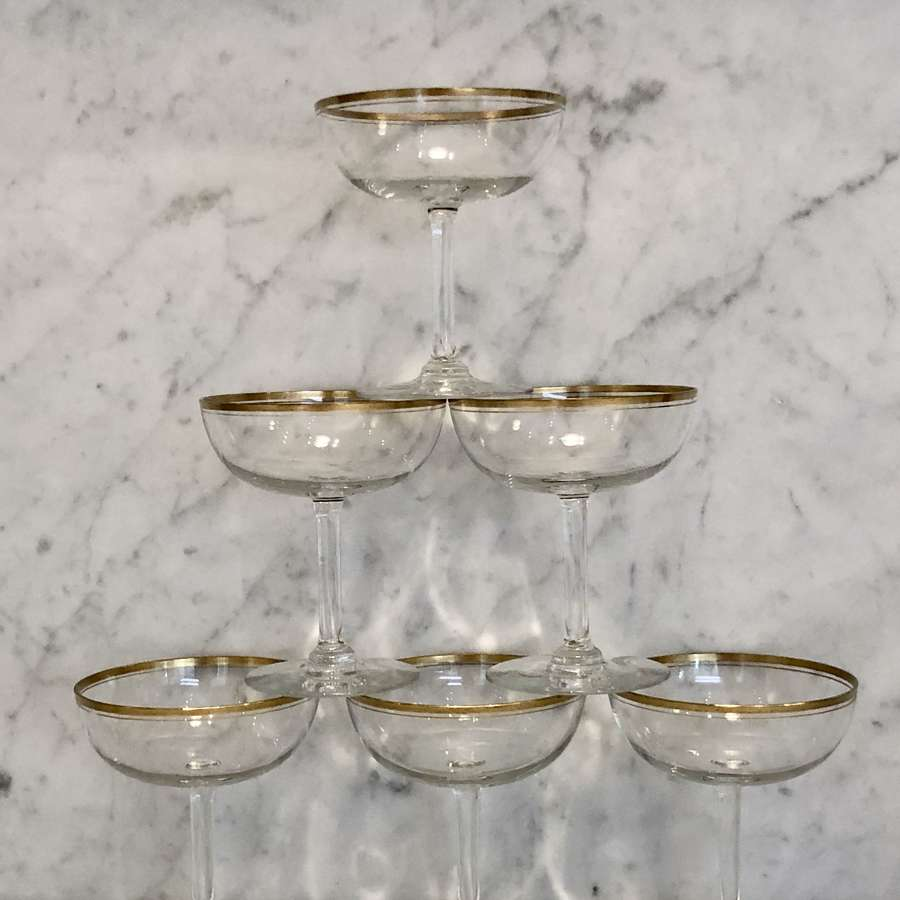 Six French gold rimmed champagne coupes or saucers