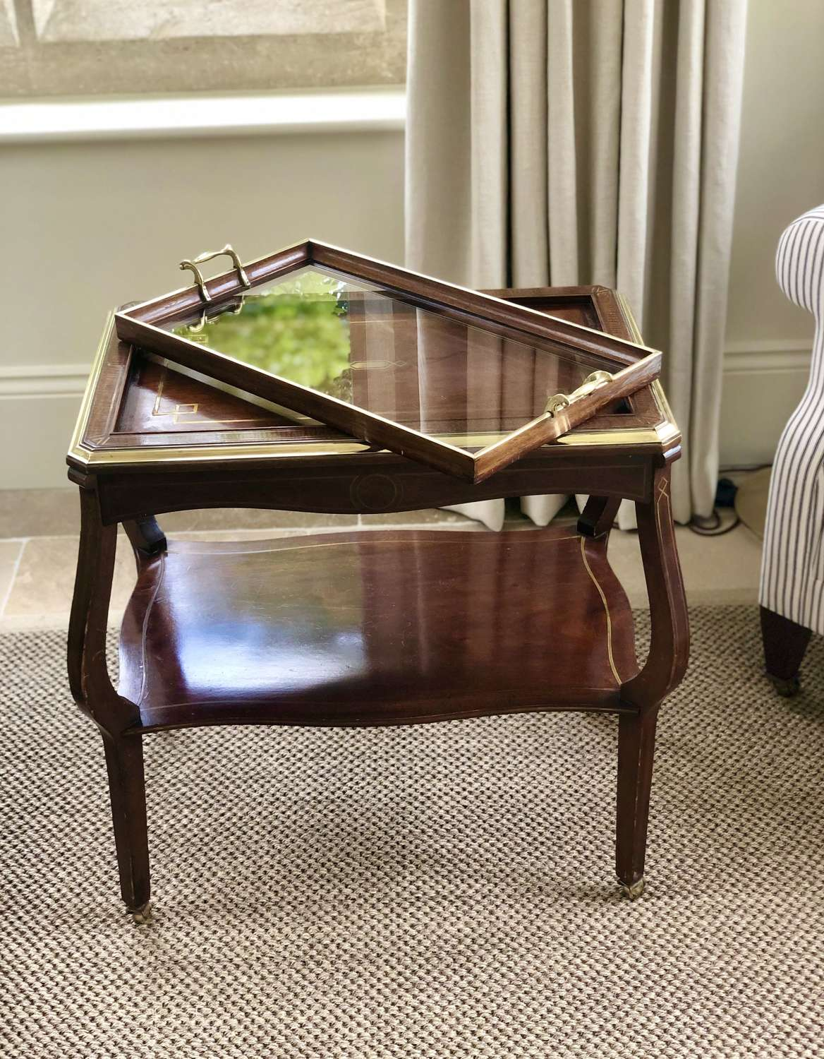 Exemplary Edwardian mahogany brass inlaid serving or drinks trolley