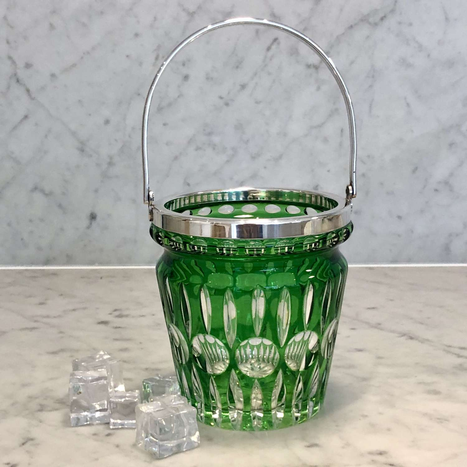 Green cut to clear glass ice bucket with silver plated swing handle