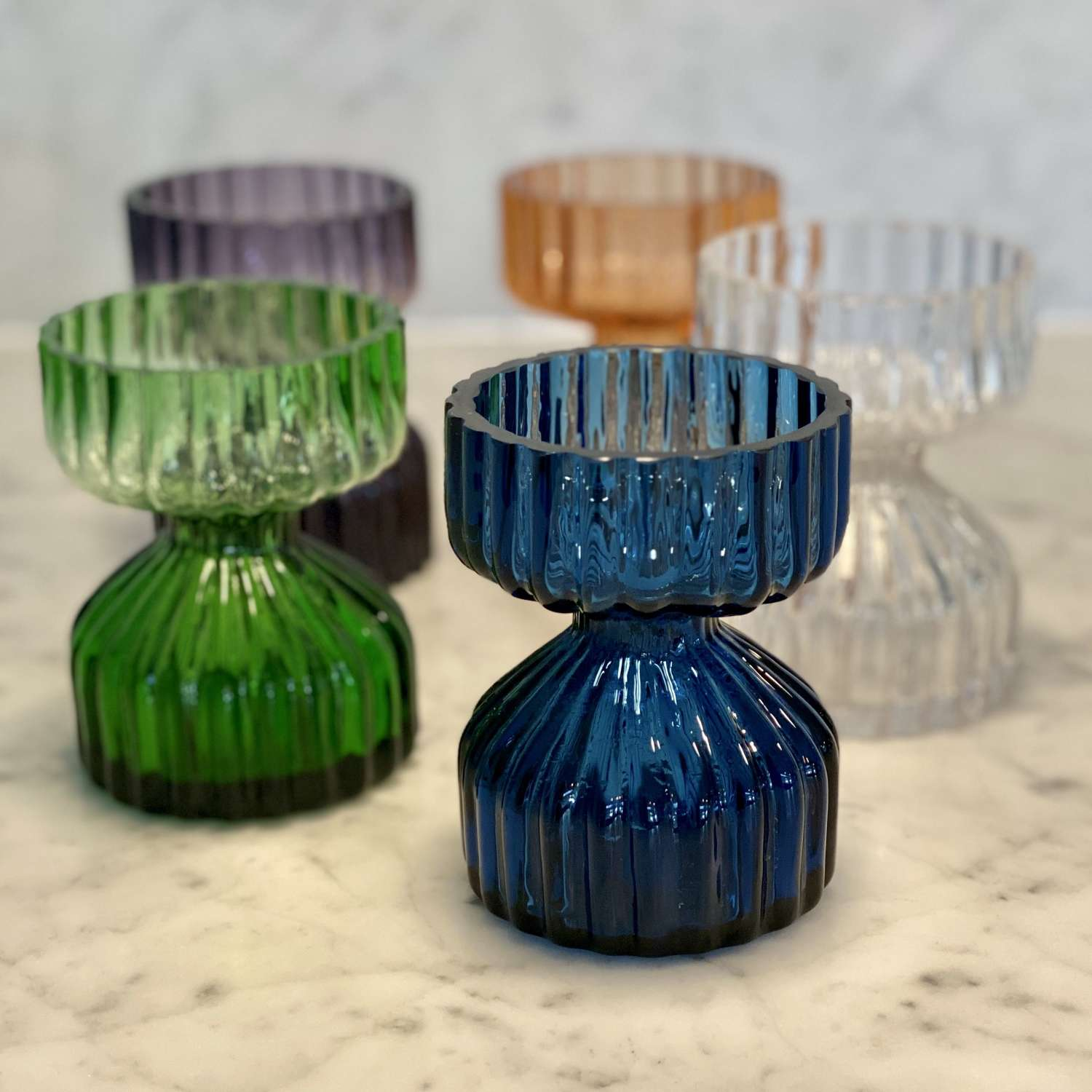 A cluster of Wedgwood glass candlestick holders or posy vases