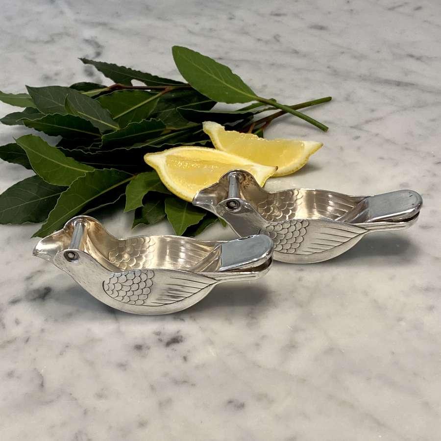 Pair of fun Art Deco silver plated bird lemon squeezers