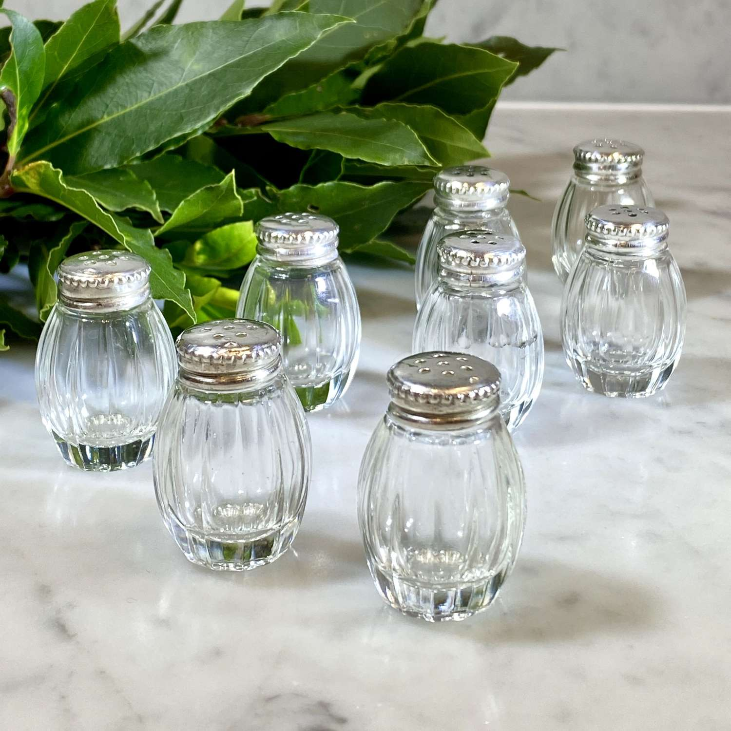 8 individual Christofle silver and crystal salt or pepper shakers