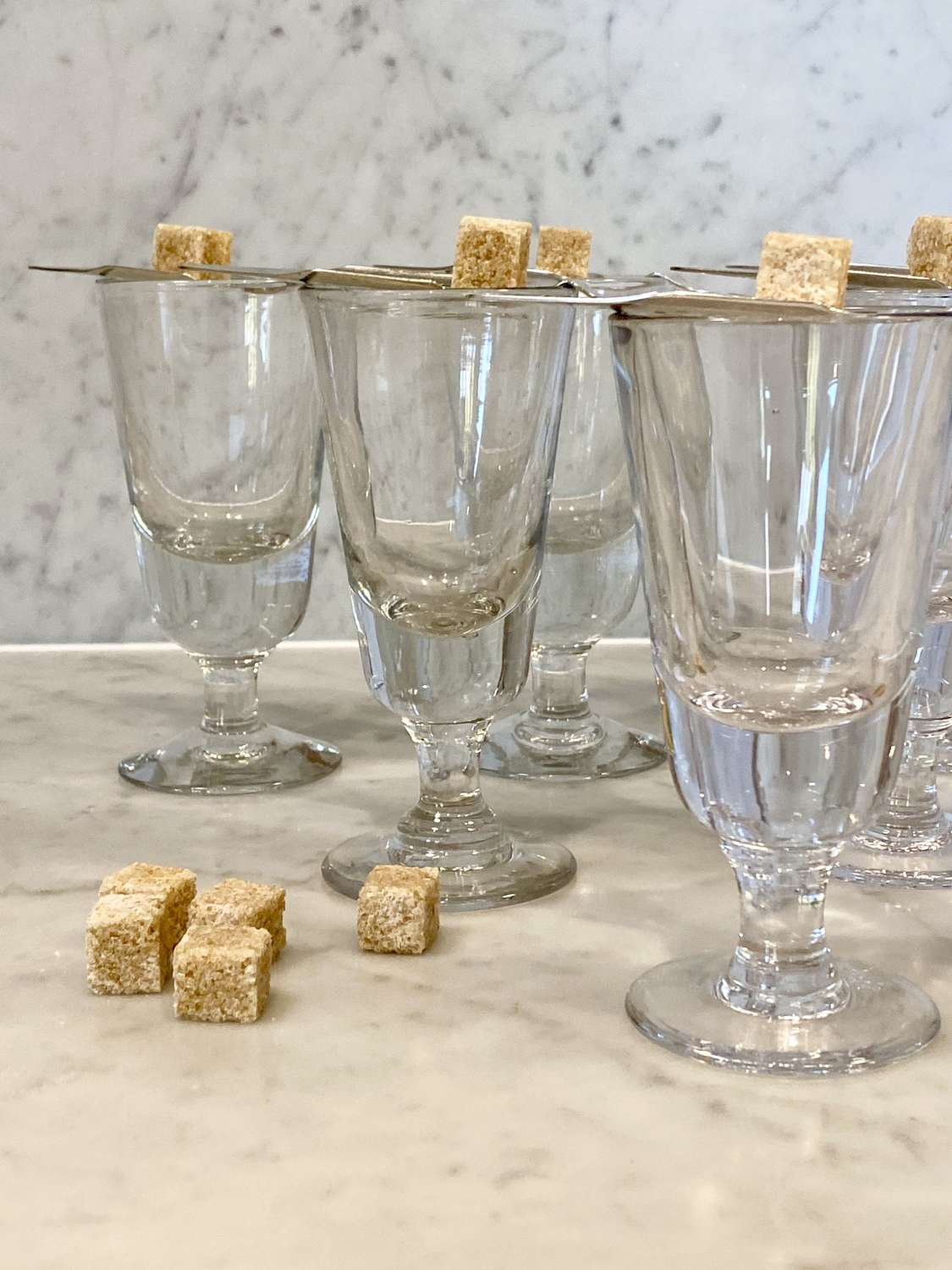 Set of French Bistro glasses and silver plated Absinthe spoons