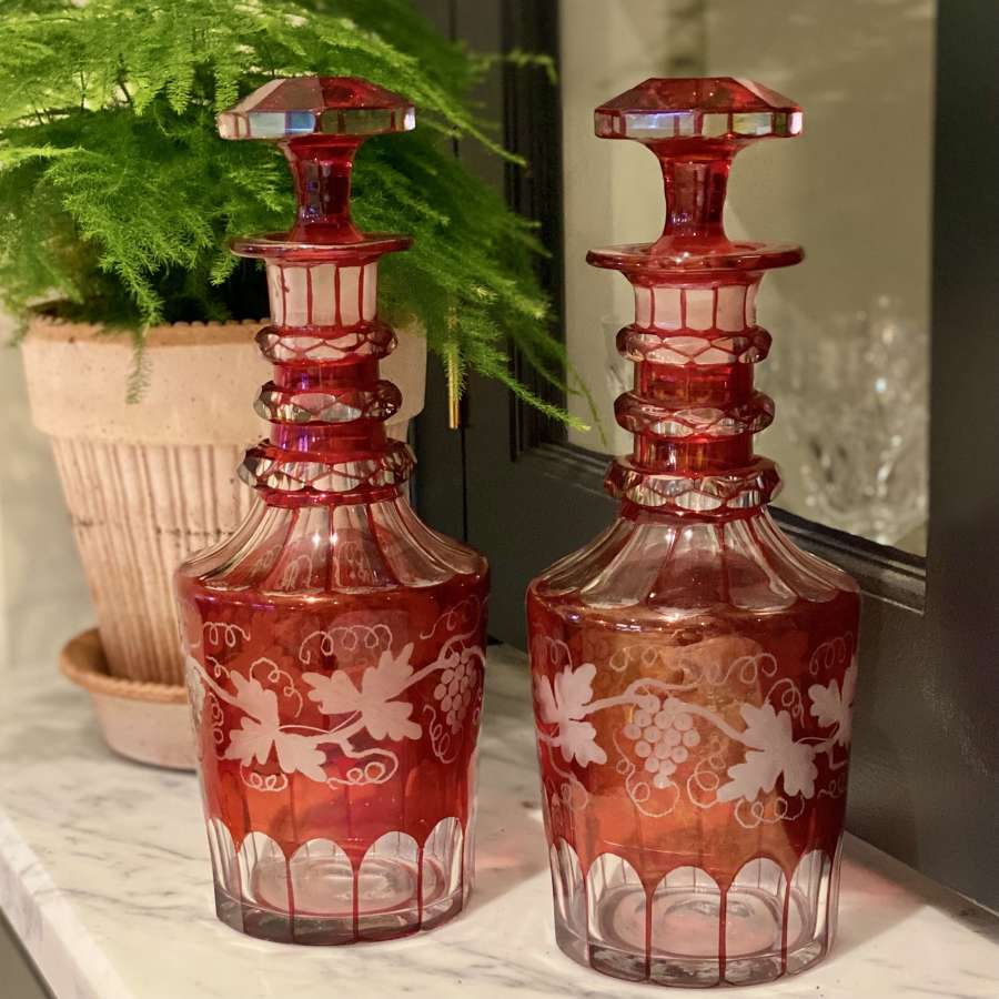 Pair of Biedermeier fruiting vine etched early Victorian decanters