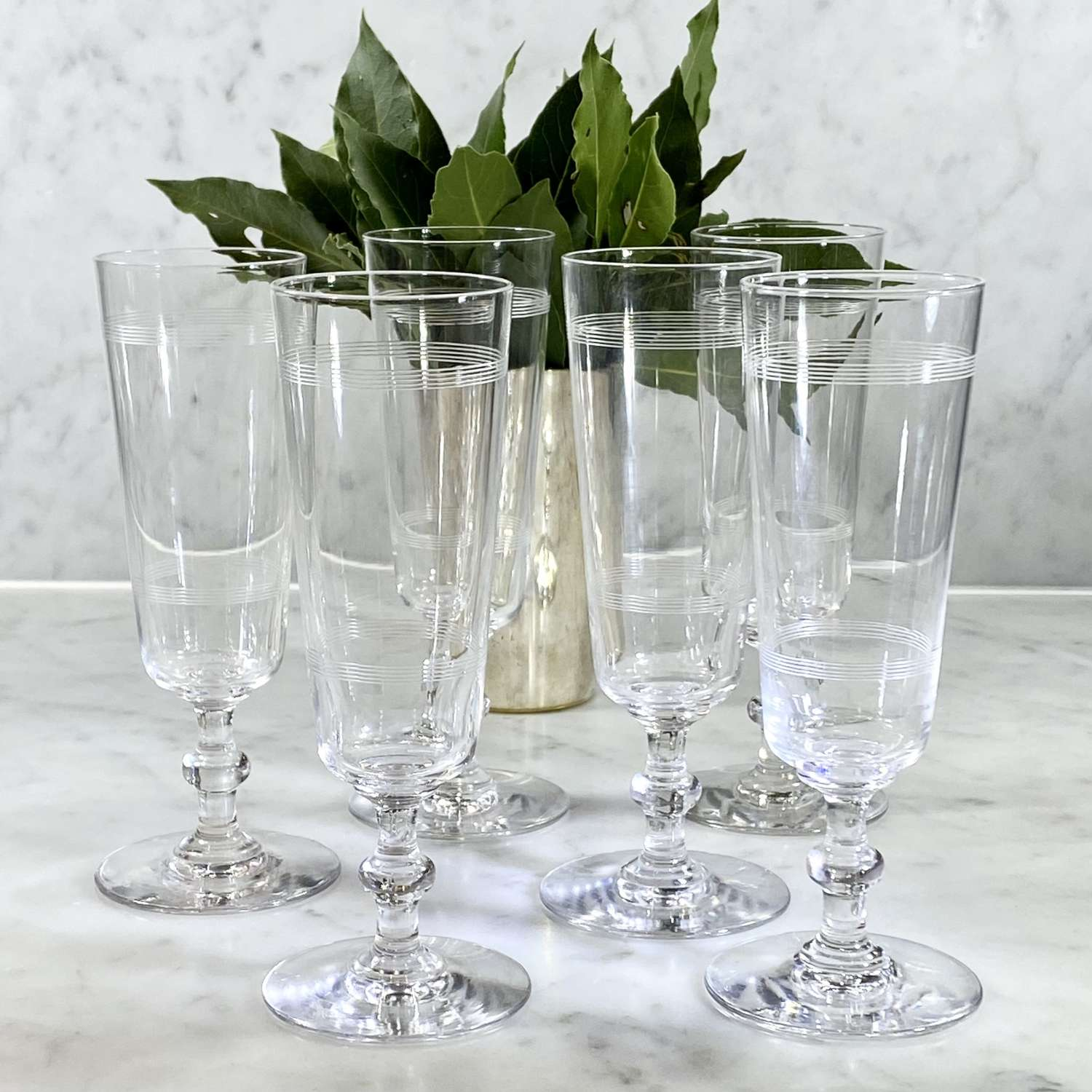 Six Art Deco etched crystal flutes attributed to Baccarat