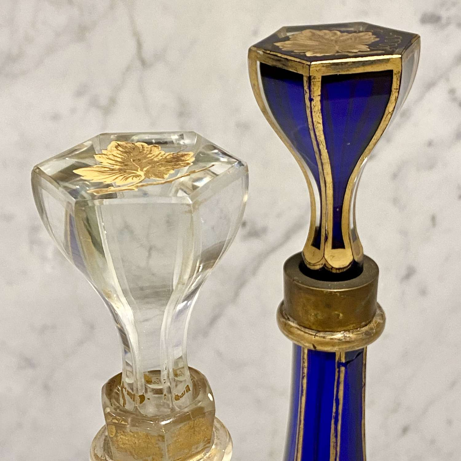 Early Victorian pair of gilded overlay and cut to clear decanters