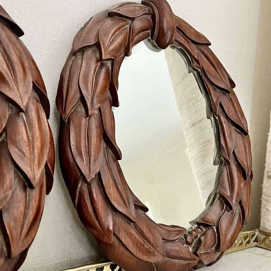Pair of William IV carved mahogany laurel wreath mirrors