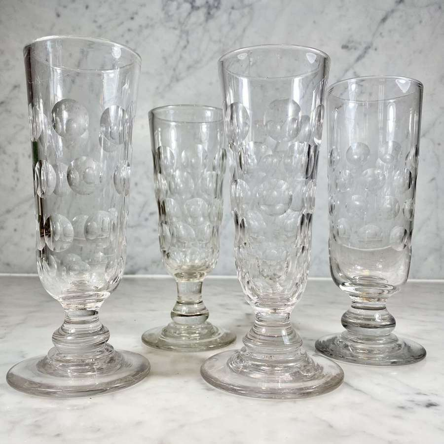 Four 19th Century tall hand blown and lens cut Ale glasses