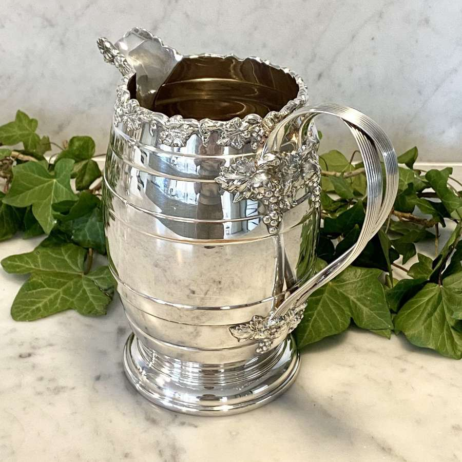 Smart Victorian silver plated vine and ribbon wine jug