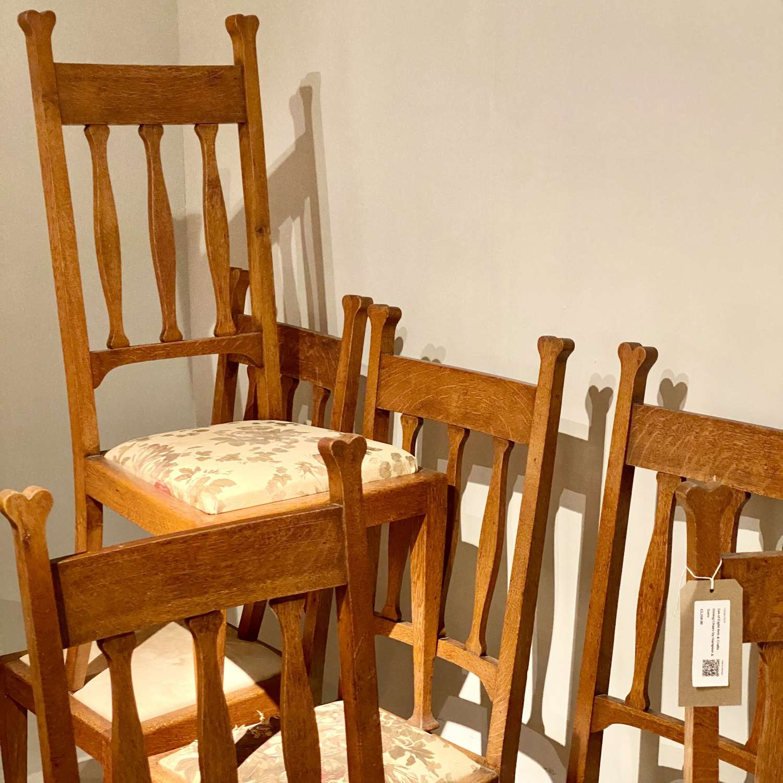 Set of 8 Art & Crafts golden oak dining chairs