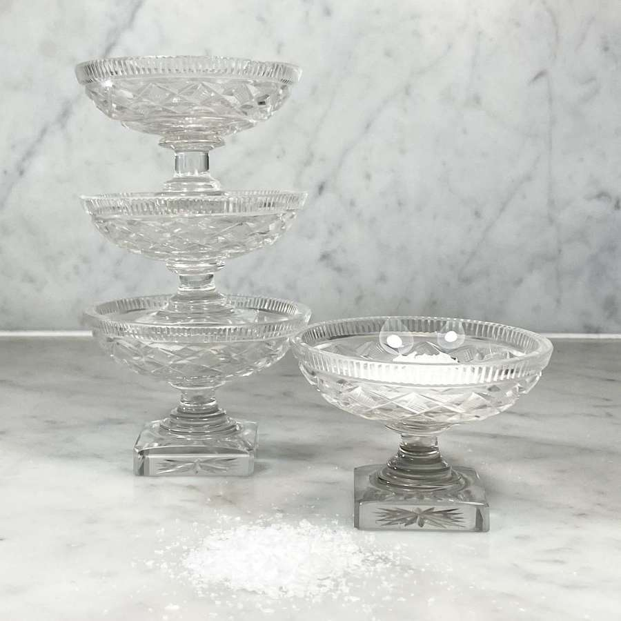 Set of four Georgian cut glass pedestal salts