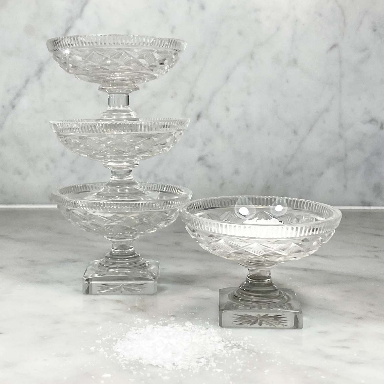 Set of four Georgian cut glass pedestal salts