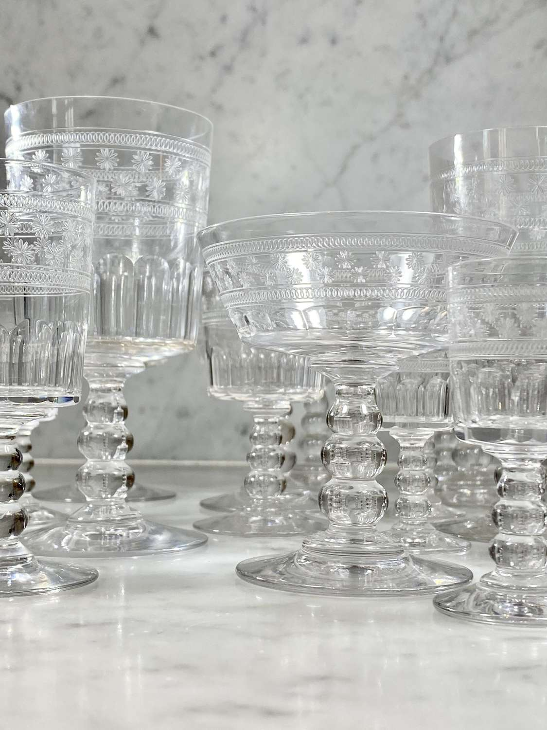 Collection of 19 early 20th C etched Baccarat drinking glassware