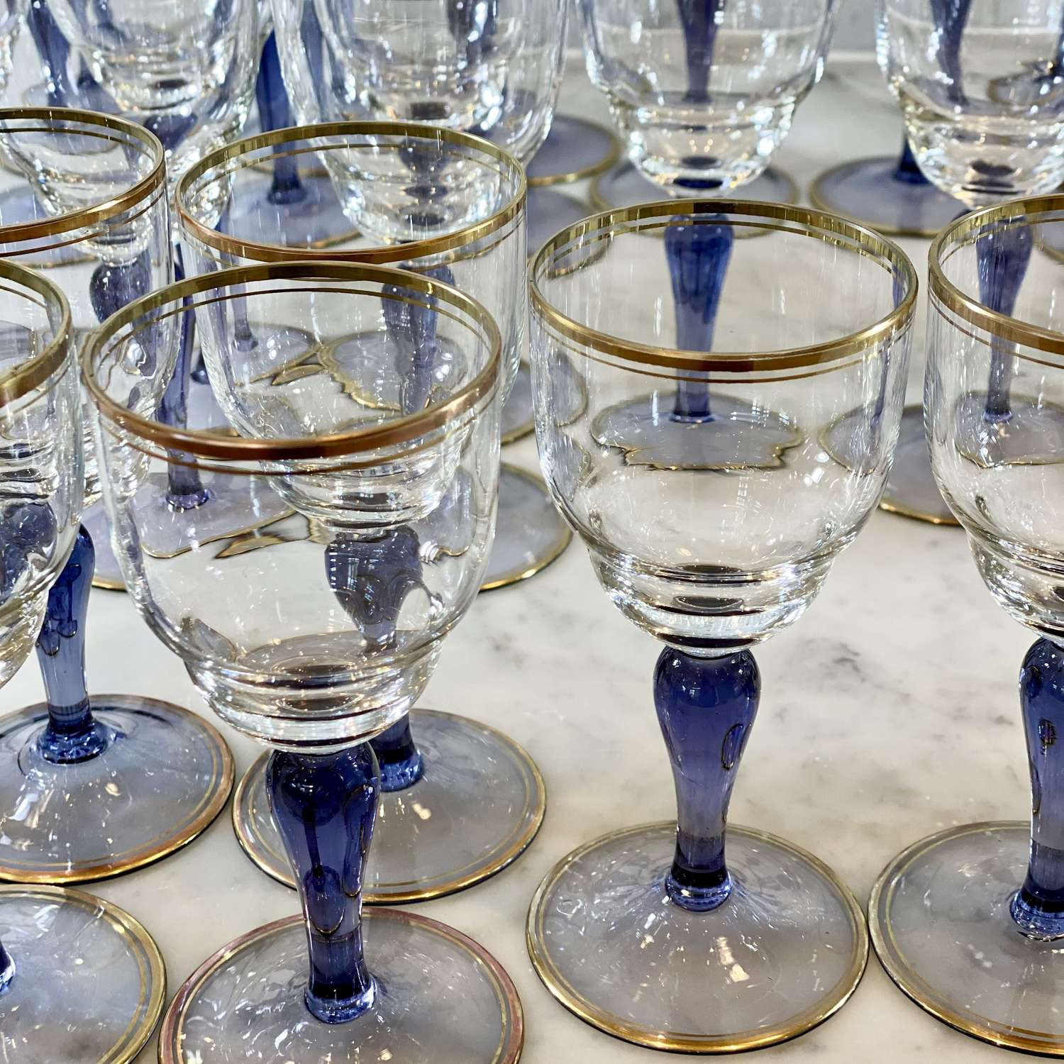 Suite of 42 French Art Deco gold rim lilac glass stem wine glasses