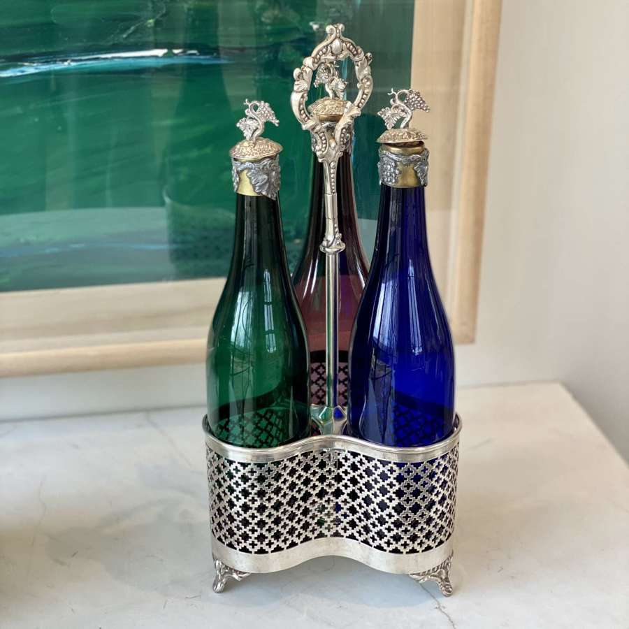 Triple Victorian wine bottle decanters & coaster stand