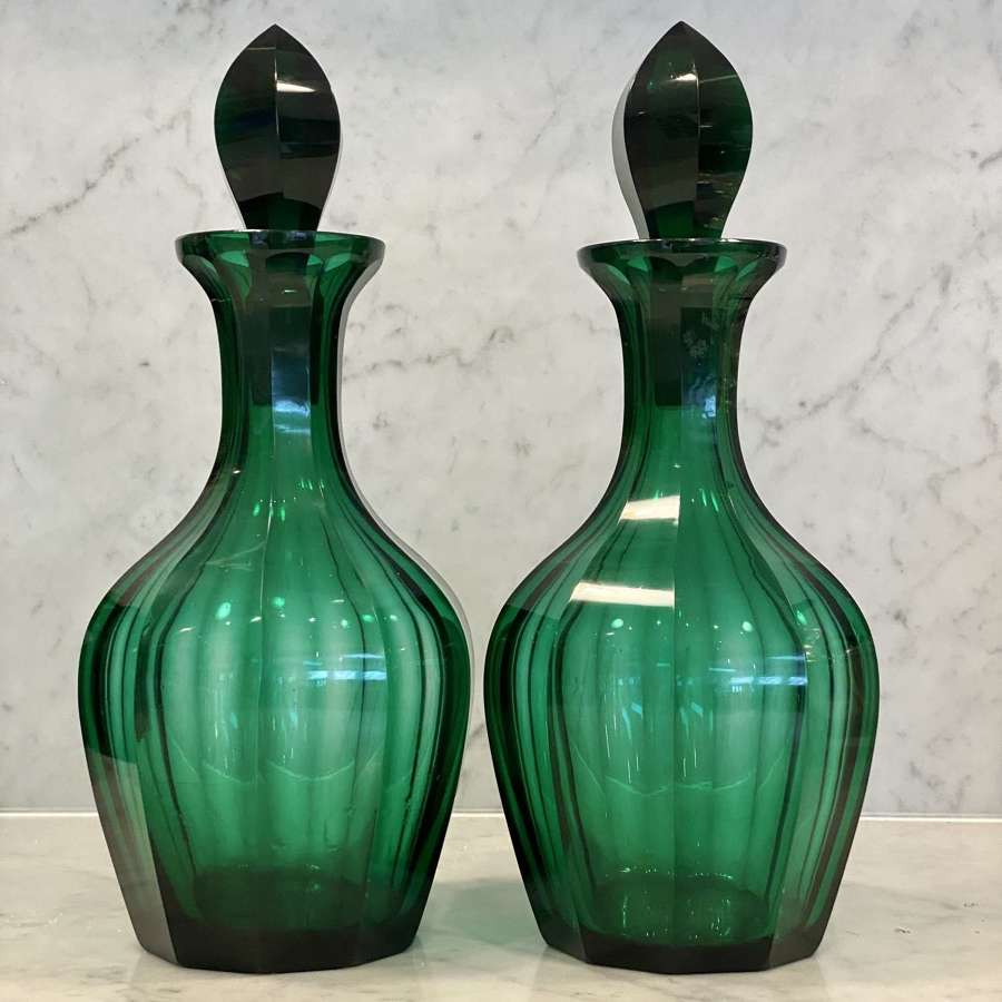 Pair of Victorian green glass Magnum decanters