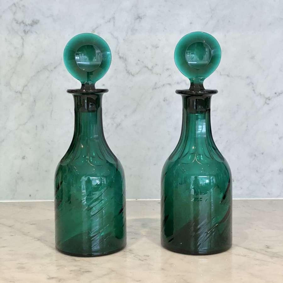 Pair of Georgian wrythen glass Bullseye stopper decanters